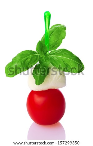 Italian cuisine: tomato, mozzarella, basil - stock photo