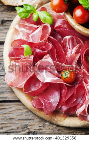 Italian Delicious Antipasto with ham and bresaola, selective focus - stock photo