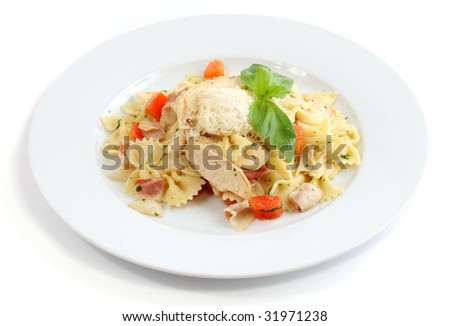 Italian dish: Farfalle with chicken, bacon and cheese on white background