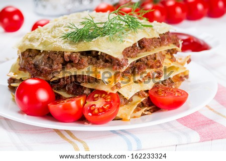 Italian dish lasagna with meat and cherry tomatoes