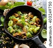 Italian dish, Potato Gnocchi with addition of herb pesto, cheese and mushrooms - stock photo