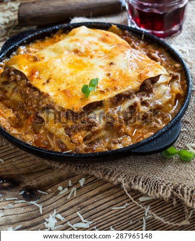 Italian dish. Traditional Italian lasagna cooked in a frying pan - stock photo