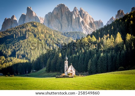 Italian Dolomites Alps in a beautiful sunny day. Odle Mountains and Santa Maddalena, Val di Funes - stock photo