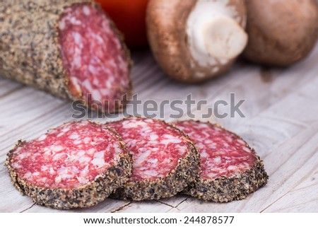 Italian dried salami crusted in ground black pepper