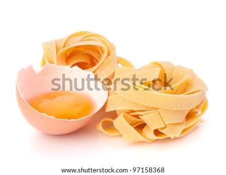 Italian egg pasta fettuccine nest isolated on white background - stock photo