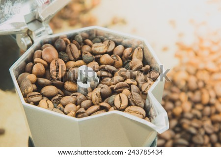 italian espresso coffee pot with coffe bean on a jute background - stock photo