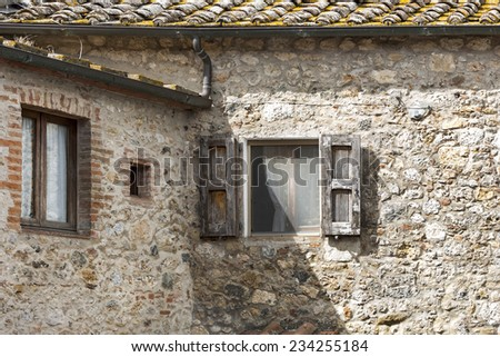 Italian facade with old wooden framed windows in Italy - stock photo