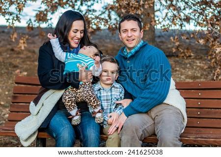 Italian family enjoying a day at the park -- taken at San Rafael Park in Reno, Nevada, USA  - stock photo