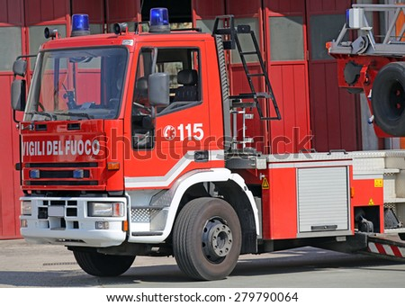 italian fire trucks with lettering on the door - stock photo