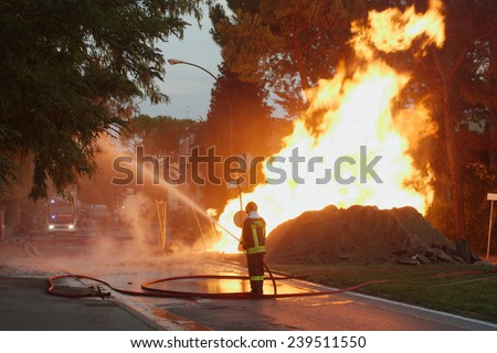 Italian firefighters in action  - stock photo