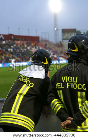 Italian firefighters with uniform with the written FIREFIGHTERS do the security service during the sporting event