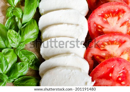italian flag made of  food concept. Italian tasty food. italian caprese salad made of mozzarella, basil and tomatoes.