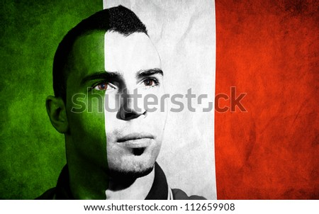 Italian flag painted on his face. - stock photo