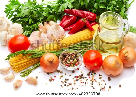 Italian food and drink cooking concept: Fresh fragrant Italian vegetables herbs spices & pasta. Tomatoes, mushrooms, onion,pasta penne, peppers, parsley, rosemary, olive oil, garlic. White background.