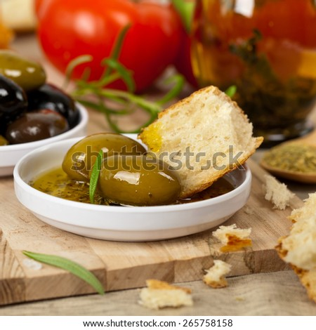 Italian food appetizer of bread and olive oil. Selective focus. - stock photo