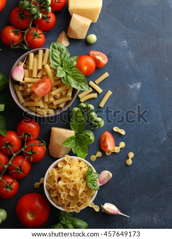 italian food background, raw ingredients top view on slate