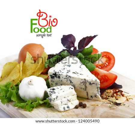Italian food (cheese, garlic, pepper, basil, salad) over white - stock photo