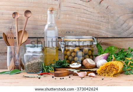 Italian food concept pasta with vegetables olive oil flavored and sesame oil with spices herb rosemary ,thyme,dill,sage,parsley and champignon mushroom set up with old wooden background. - stock photo