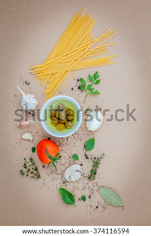 Italian food concept pasta with vegetables olive oil flavored with spices herb rosemary ,thyme,parsley and champignon mushroom set up with brown background. - stock photo