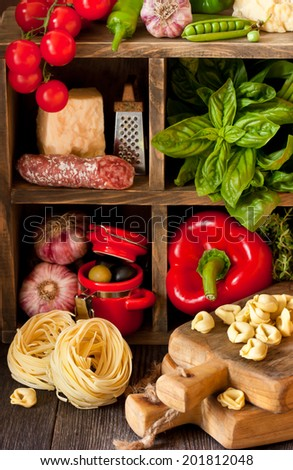 Italian food. Fresh food ingredients for cooking on a rustic kitchen. - stock photo