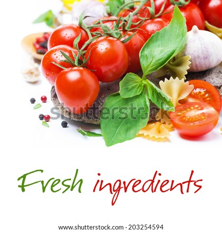 Italian food ingredients - fresh cherry tomatoes, basil and pasta, close-up, isolated on white - stock photo