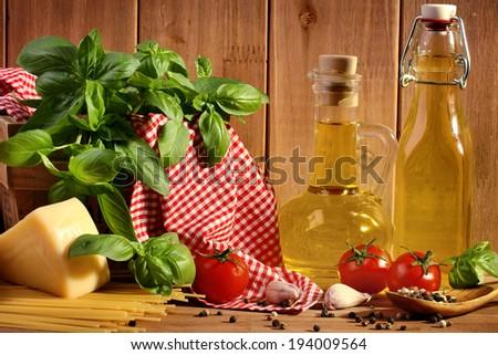 Italian food ingredients on wooden background - stock photo