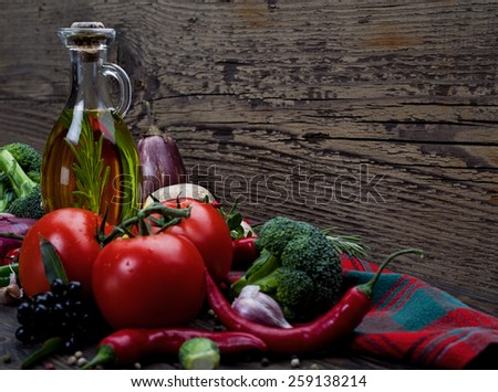 Italian food ingredients: pasta, tomatoes, mushrooms, herbs, vegetables, nuts and spices on wooden background - stock photo