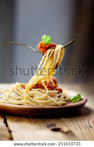 Italian food. Pasta spaghtti with tomato sauce, olives and garnish