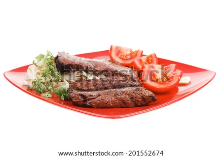 italian food : pasta with tomato and grilled sirloin beef on red plate isolated over white background - stock photo