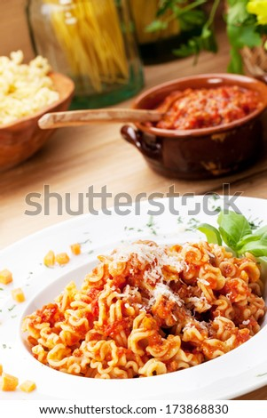 Italian food: pasta with tomato sauce and parmesan cheese.