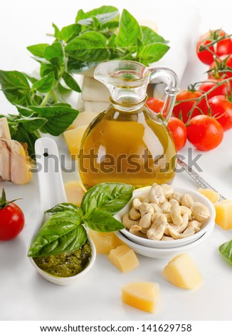 Italian food - pesto and ingredients isolated on white. Selective focus