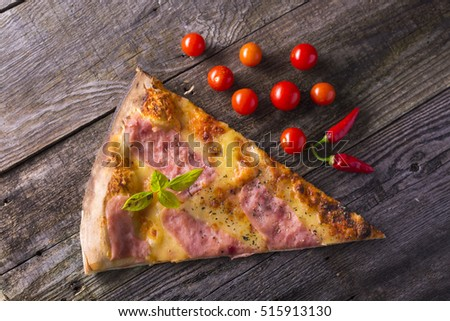 Italian food - pizza on wooden table. Cherry tomato and hot peppers