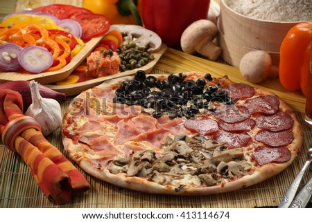 Italian food setup with vegetable and fresh pizza