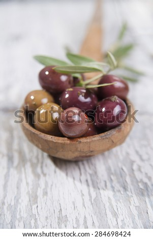 Italian food, snack of olives in brine presented in flat - stock photo