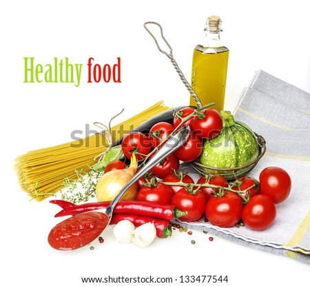 italian food with vegetable, olive oil, spaghetty and tomato ketchup - white background - stock photo