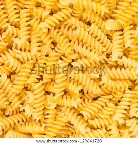 Italian Fusilli or Rotini helix shaped Macaroni Pasta raw food background or texture close up - stock photo