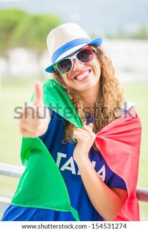 Italian Girl Supporter at Stadium - stock photo
