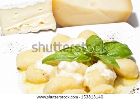 Italian Gnocchi stuffed with four cheeses - stock photo
