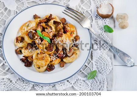 Italian gnocchi with wild mushrooms - stock photo