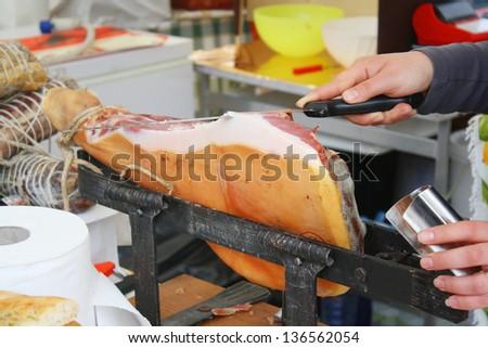 Italian ham prosciutto at the butchery, farm butcher shop - stock photo