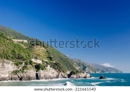 Italian holidays - beautiful Monterosso al Mare Beach, Cinque Terre, Italy. fishermen village in Cinque Terre, unesco world heritage in Italy. pictorial coast of Italy, Liguria. - stock photo
