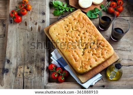 Italian homemade focaccia bread. rustic tortilla. traditional recipe of Italian cuisine - stock photo