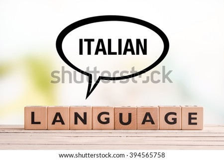 Italian language lesson sign made of cubes on a table - stock photo