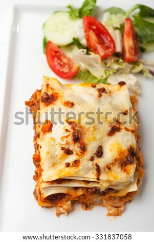 italian lasagna on a square plate  - stock photo