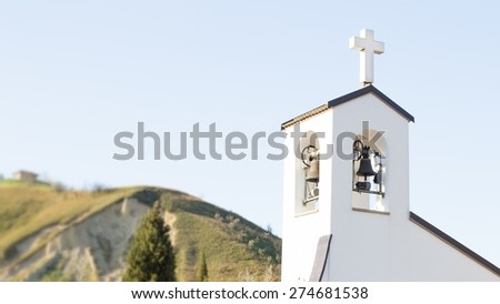 Italian little church with blurred landscape background / Countryside chapel - stock photo