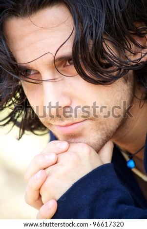 Italian male fashion model thinking and looking away - stock photo
