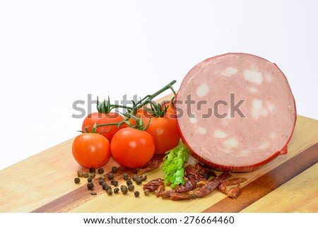 Italian Mortadella Bologna with tomatoes and vegetables - stock photo
