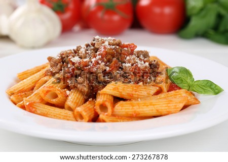 Italian noodles pasta Bolognese sauce meal on a plate - stock photo