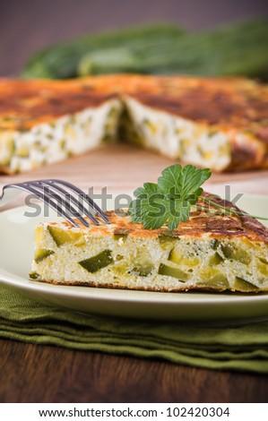 Italian omelette with zucchini. - stock photo