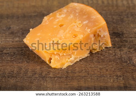 Italian Parmesan Cheese on Wooden Background close up - stock photo